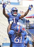 Kansas running back Pooka Williams Jr. (1) is hoisted up by Kansas offensive lineman Malik Clark (61) after a touchdown during the fourth quarter on Saturday, Sept. 15, 2018 at Memorial Stadium.