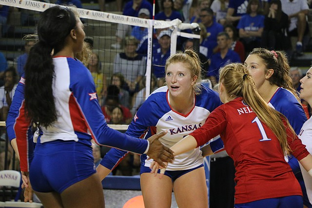 Senior right side Gabby Simpson talks with her team after a Kansas point. Simpson had seven blocks in the team's 3-1 win over Drake Tuesday night.