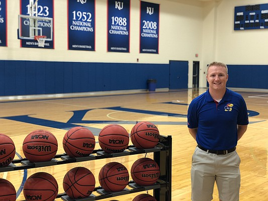 """KU basketball manager Riley Cobb, known as """"Ollie,"""" poses inside the Jayhawks practice gym just a few hours after surprising everyone by jumping into KU's conditioning drills."""