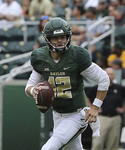 Baylor quarterback Charlie Brewer (12) rolls out of the pocket against Kansas during the first half of an NCAA college football game, Saturday, Sept. 22, 2018, in Waco, Texas.