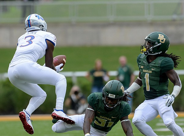 Kansas wide receiver Evan Fairs (3) drops a pass covered by Baylor cornerback Harrison Hand (31) and Baylor safety Verkedric Vaughns (1) during the first half of an NCAA college football game, Saturday, Sept. 22, 2018, in Waco, Texas.