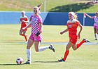 Senior forward Grace Hagan makes a pass to defender Elise Reina late in the second half. Kansas fell 2-1 to No. 15 Oklahoma State Sunday afternoon.