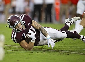 Texas A&M tight end Jace Sternberger (81) lunges forward at the end of a catch against Clemson during the first half of an NCAA college football game Saturday, Sept. 8, 2018, in College Station, Texas. (AP Photo/Sam Craft)