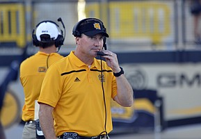 Kennesaw State head coach Brian Bohannon talks into his head set during an NCAA college football game against Edward Waters, Saturday, Sept. 12, 2015, in Kennesaw, Ga. (AP Photo/Lisa Marie Pane)