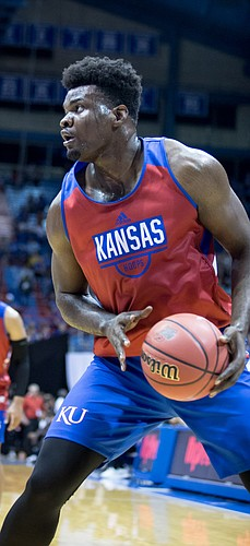 KU center Udoka Azubuike takes a step back to assess the situation during the men's basketball scrimmage at Late Night in the Phog on Friday, Sept. 28, 2018 at Allen Fieldhouse.