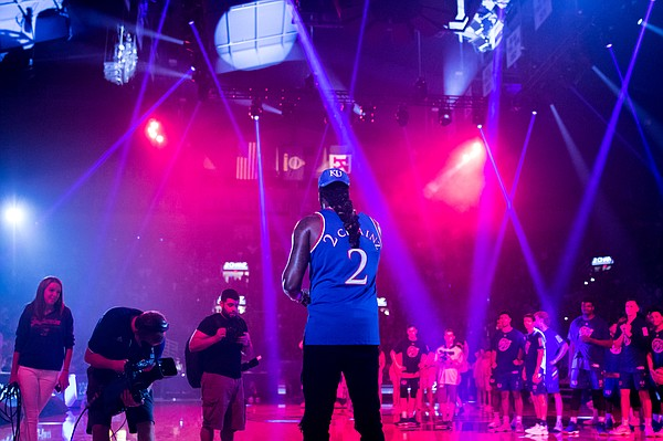 The teams and media watch as 2 Chainz performs at Late Night in the Phog on Friday, Sept. 28, 2018 at Allen Fieldhouse.