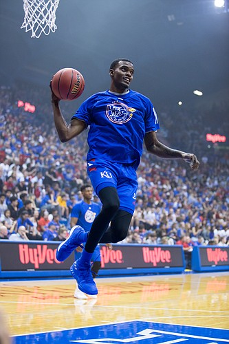 e870004883cf Kansas senior Lagerald Vick flies through the air during warmups for the Late  Night scrimmage