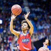 Senior guard Christalah Lyons shoots a 3-pointer in the 3-point contest at Late Night in the Phog on Friday, Sept. 28, 2018 at Allen Fieldhouse.