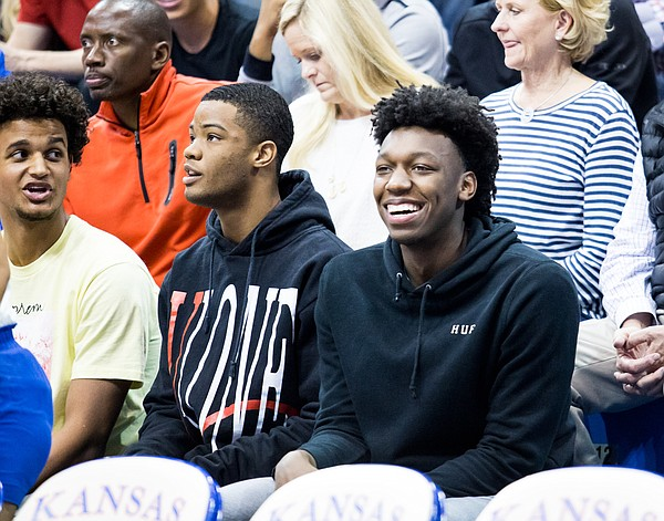 Kansas basketball recruits, from left to right, Jeremiah Robinson-Earl, Cassius Stanley and James Wiseman, take in the scene at Late Night in the Phog on Friday, Sept. 28, 2018.