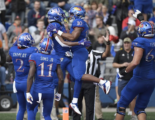 Kansas wide receiver Kwamie Lassiter celebrates with running back Khalil Herbert following a touchdown against Oklahoma State on Saturday, Sept. 29, 2018.