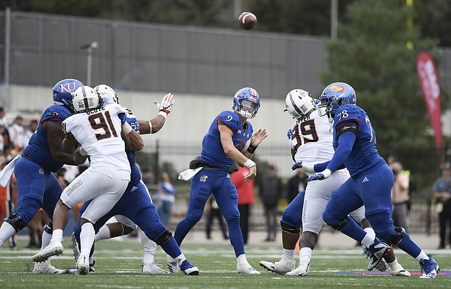 Kansas junior quarterback Carter Stanley throws the ball downfield to a teammate on Saturday, Sept. 29, 2018.