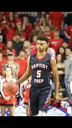 "Four-star Little Rock, Ark., point guard Issac ""Mackey"" McBride brings the ball up the floor and looks to initiate offense during a prep game last season. (Photo by Nick Wenger)"