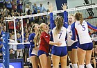 Kansas celebrates a match win after against West Virginia Wednesday night. The Jayhawks rallied back down two sets to earn a 3-2 win over the Mountaineers.