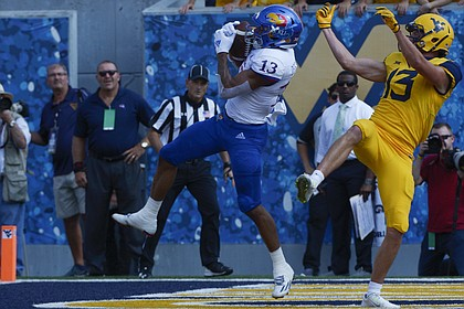 Kansas cornerback Hasan Defense (13) intercepts a pass in the end zone during intended for West Virginia wide receiver David Sills V (13) during the first half  of an NCAA college football game in Morgantown, W. Va., Saturday Oct. 6, 2018. (Craig Hudson/Charleston Gazette-Mail via AP)