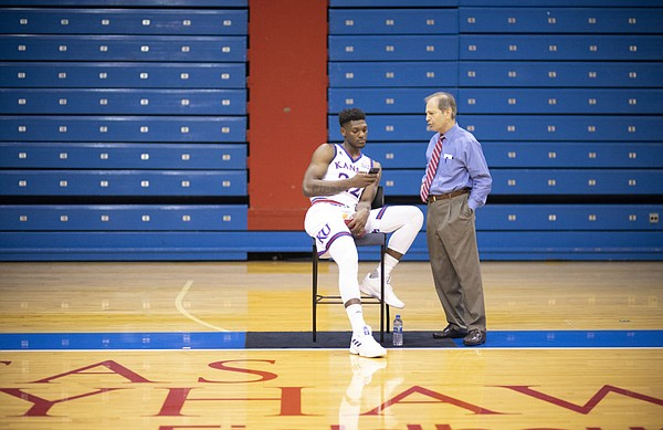 Kansas forward Silvio De Sousa talks with associate athletics director for public affairs Jim Marchiony during Media Day, Wednesday, Oct. 10, 2018 at Allen Fieldhouse.