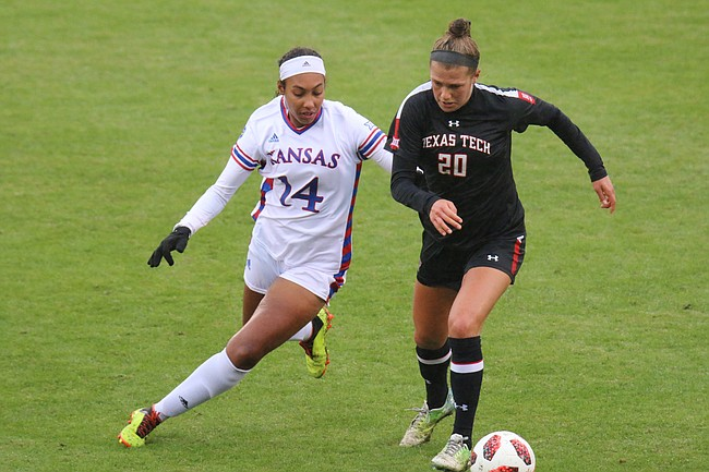 Freshman forward Samantha Barnett defends Red Raider midfielder Jayne Lydiatt. Kansas dropped a 2-1 decision to Texas Tech Sunday afternoon at Rock Chalk Park.