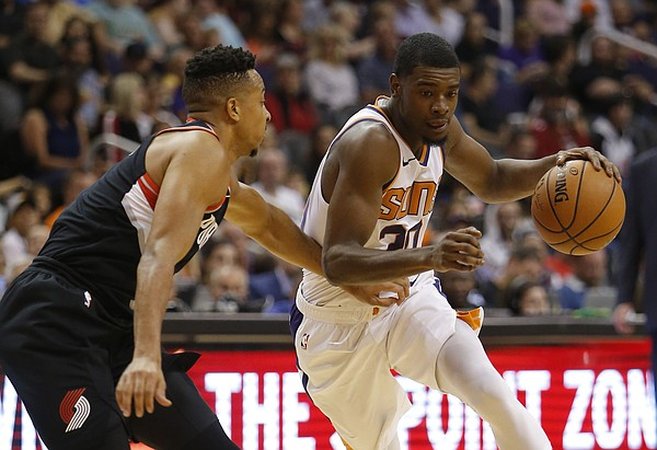 Phoenix Suns forward Josh Jackson (20) in the first half during an NBA preseason basketball game against the Portland Trail Blazers, Friday, Oct. 5, 2018, in Phoenix. (AP Photo/Rick Scuteri)