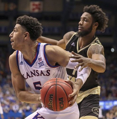 Kansas guard Quentin Grimes (5) drives against Emporia State forward Justin Tucker (1) during the second half of an exhibition, Thursday, Oct. 25, 2018 at Allen Fieldhouse.