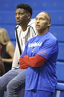 Kansas forward Silvio De Sousa watches warmups alongside assistant coach Norm Roberts, Thursday, Oct. 25, 2018 at Allen Fieldhouse.