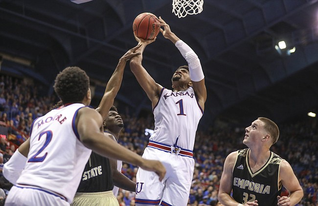Kansas forward Dedric Lawson (1) puts up a shot over Emporia State forward Kooper Glick (32) and the Emporia State defense during the second half of an exhibition, Thursday, Oct. 25, 2018 at Allen Fieldhouse.