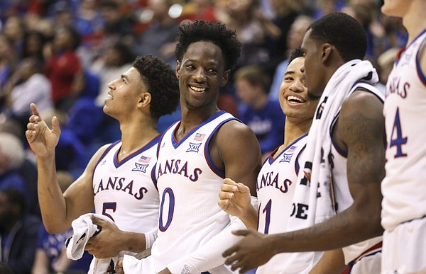 Kansas guard Marcus Garrett (0) and the KU bench get excited after a three by Kansas guard Ochai Agbaji (30) during the second half of an exhibition, Thursday, Oct. 25, 2018 at Allen Fieldhouse.