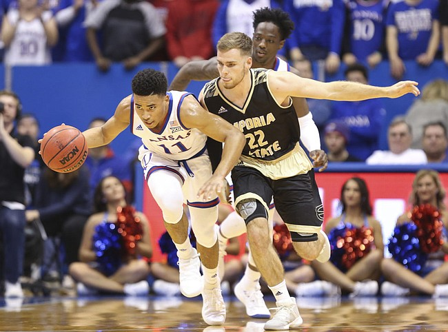 Kansas guard Devon Dotson (11) pushes the ball up the court against Emporia State guard Jack Dale (22) during the first half of an exhibition, Thursday, Oct. 25, 2018 at Allen Fieldhouse.