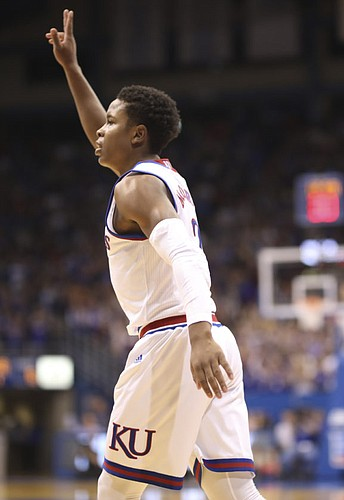 Kansas guard Charlie Moore (2) signals after hitting a three during the first half of an exhibition, Thursday, Oct. 25, 2018 at Allen Fieldhouse.