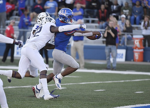 Kansas running back Pooka Williams Jr. reaches out for a touchdown against TCU Saturday.