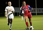 Defender Addisyn Merrick chases a ball past Texas' Katie Glenn at the Big 12 Soccer Championships in Swope Soccer Village on Sunday, October 28.