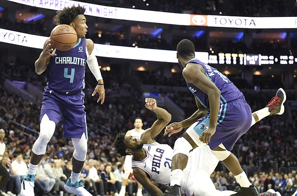 400df21ed514 Charlotte Hornets  Devonte  Graham (4) picks up a loose ball as Philadelphia