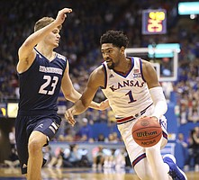 Kansas forward Dedric Lawson (1) drives against Washburn forward Will McKee (23) during the first half of an exhibition, Thursday, Nov. 1, 2018 at Allen Fieldhouse.