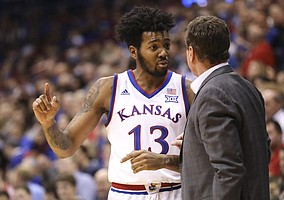 Kansas guard K.J. Lawson (13) talks with Kansas head coach Bill Self during a break from action in the second half of an exhibition, Thursday, Nov. 1, 2018 at Allen Fieldhouse.