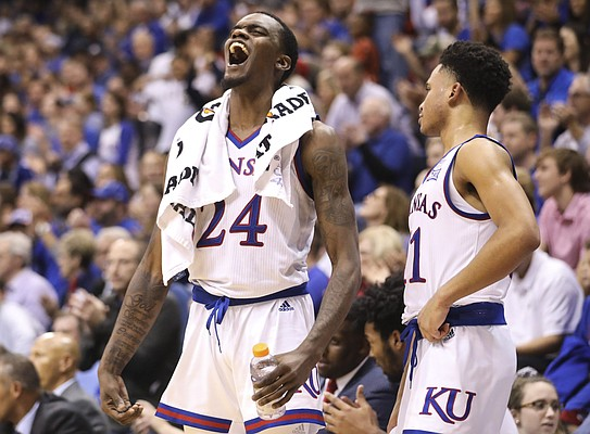 Kansas guard Lagerald Vick (24) celebrates a dunk by teammate David McCormack (33) during the second half of an exhibition, Thursday, Nov. 1, 2018 at Allen Fieldhouse.
