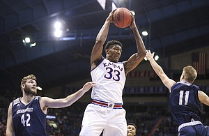 Kansas forward David McCormack (33) pulls down a rebound from Washburn forward Jonny Clausing (42) and Washburn guard Tommy Ekart (11) during the second half of an exhibition, Thursday, Nov. 1, 2018 at Allen Fieldhouse.
