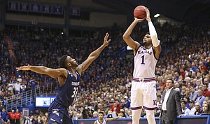 Kansas forward Dedric Lawson (1) pulls up for a three over Washburn guard Emeka Ogbonna (32) during the second half of an exhibition, Thursday, Nov. 1, 2018 at Allen Fieldhouse.
