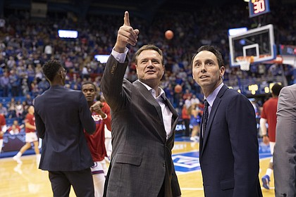 Kansas head coach Bill Self catches up with Washburn head coach Brett Ballard prior to tipoff of an exhibition, Thursday, Nov. 1, 2018, at Allen Fieldhouse.