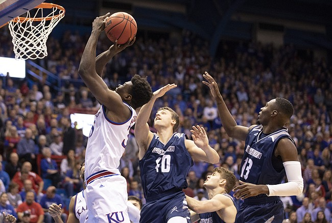 Kansas center Udoka Azubuike (35) gets to the bucket past Washburn forward David Salach (40) and Washburn guard Tyas Martin (13) during the first half of an exhibition, Thursday, Nov. 1, 2018, at Allen Fieldhouse.