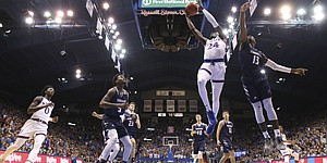 Kansas guard Lagerald Vick (24) gets to the bucket past Washburn guard Tyas Martin (13) during the first half of an exhibition, Thursday, Nov. 1, 2018, at Allen Fieldhouse.