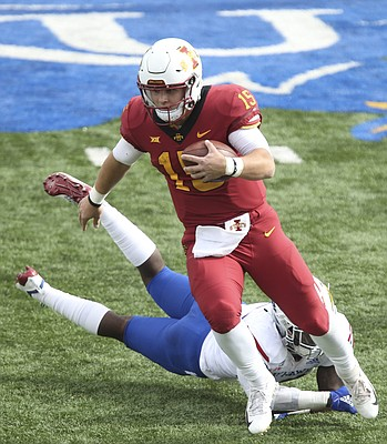 Iowa State quarterback Brock Purdy (15) loses a Kansas defender on a run during the third quarter, Saturday, Nov. 3, 2018 at Memorial Stadium.