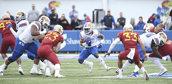 Kansas running back Pooka Williams Jr. (1) looks for a hole during the first quarter, Saturday, Nov. 3, 2018 at Memorial Stadium.