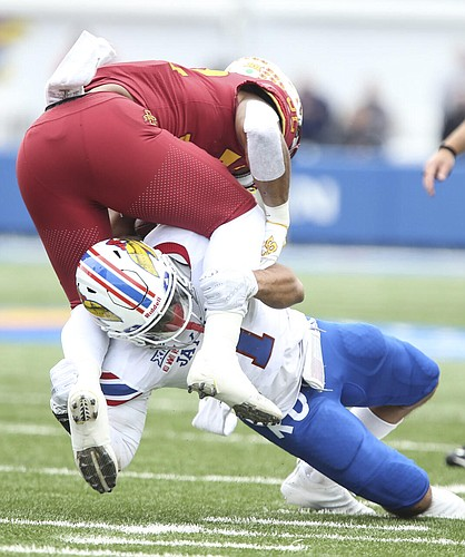 Kansas safety Bryce Torneden (1) gets under Iowa State running back David Montgomery (32) for a stop during the first quarter, Saturday, Nov. 3, 2018 at Memorial Stadium.