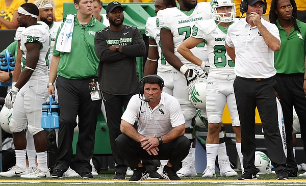 North Texas head coach Seth Littrell, center, watches from the sideline during the second half of an NCAA college football game against Iowa, Saturday, Sept. 16, 2017, in Iowa City, Iowa. (AP Photo/Charlie Neibergall)