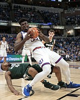 Kansas center Udoka Azubuike (35) fouls Michigan State forward Nick Ward (44) during the second half of an NCAA college basketball game at the Champions Classic on Tuesday, Nov. 6, 2018, in Indianapolis. Kansas won, 92-87.