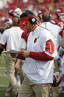 FILE - In this Sept. 5, 2015, file photo, Arkansas offensive coordinator Dan Enos walks the sideline during a timeout in the second half of an NCAA college football game against UTEP in Fayetteville, Ark. Enos left a head coaching job at Central Michigan to become the offensive coordinator at Arkansas. (AP Photo/Samantha Baker, File)