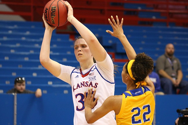 Sophomore center Bailey Helgren looks for a pass in a game against UMKC Wednesday night at Allen Fieldhouse.