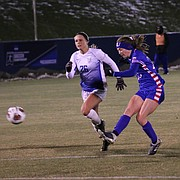 Grace Hagan takes a shot in the first half in the first half against Saint Louis. Kansas advanced to the second round of the NCAA Tournament with its 2-1 overtime win Friday at Rock Chalk Park.