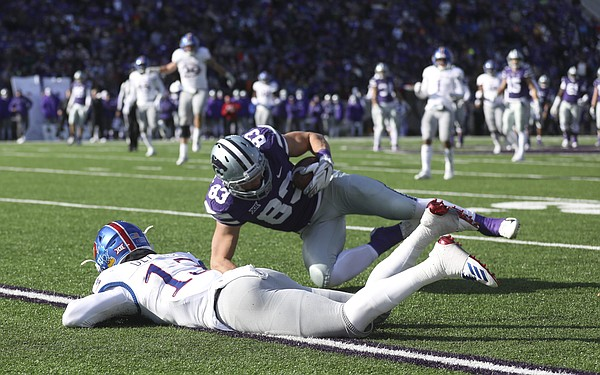Kansas State wide receiver Dalton Schoen (83) pulls in a catch before Kansas cornerback Hasan Defense (13) late in the fourth quarter on Saturday, Nov. 10, 2018 at Bill Snyder Family Stadium in Manhattan, Kan.