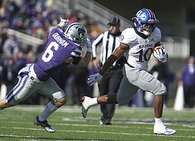 Kansas running back Khalil Herbert (10) leaves Kansas State defensive back Johnathan Durham (6) as he takes off up the field for a long run during the third quarter on Saturday, Nov. 10, 2018 at Bill Snyder Family Stadium in Manhattan, Kan.