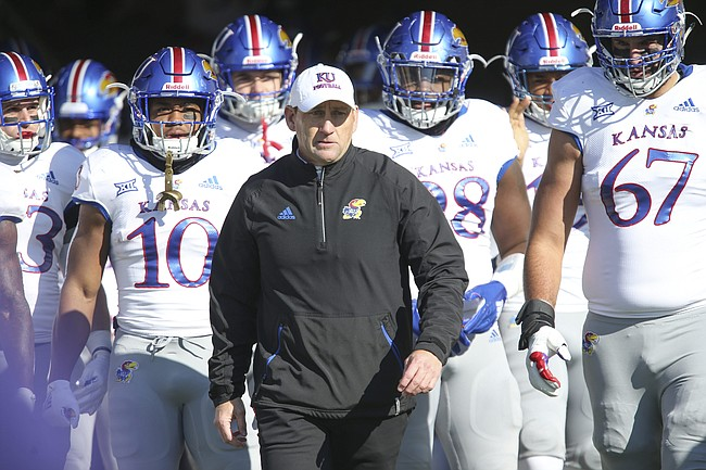 Kansas head coach David Beaty takes the field with he Jayhawks prior to kickoff on Saturday, Nov. 10, 2018 at Bill Snyder Family Stadium in Manhattan, Kan.