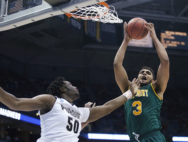 Vermont's Anthony Lamb grabs a rebound in front of Purdue's Caleb Swanigan during the first half of an NCAA college basketball tournament first round game Thursday, March 16, 2017, in Milwaukee.